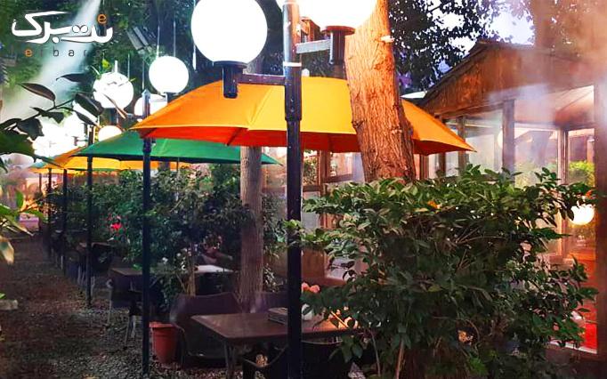 سرویس چای سنتی در باغچه رستوران گل یخ