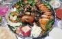 سینی غذاهای ایرانی در رستوران اکبری