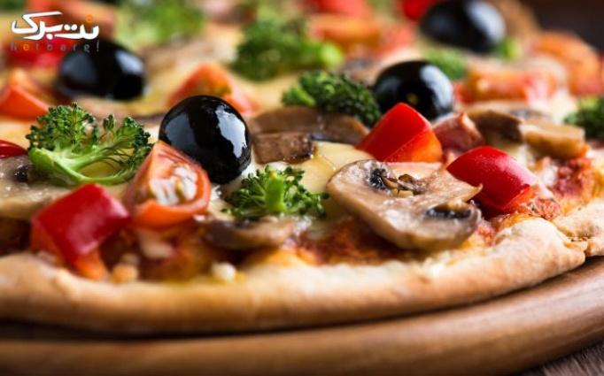 پیتزا تنوری هیزمی در رستوران ایتالیایی vip