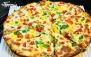 پیتزا مخلوط خوشمزه در کافی شاپ کاپیتان